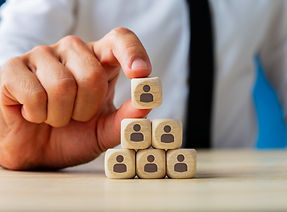 business-executive-stacking-wooden-dices