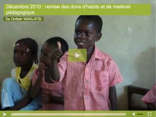 Décembre 2010 : remise des dons d'habits et de matériel pédagogique