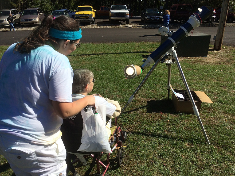 Observing a magnified projection of the sun through a Sun Funnel.