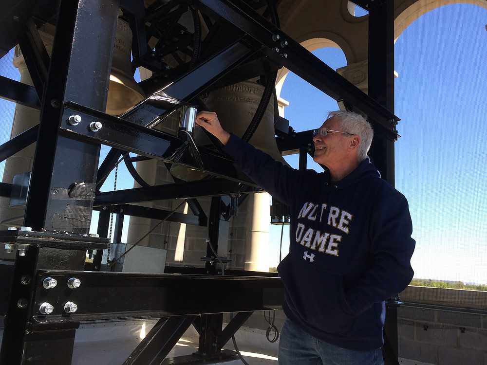 Fr. Bill Schooler uncovers the pinhole of a solargraph to begin exposing the sun.