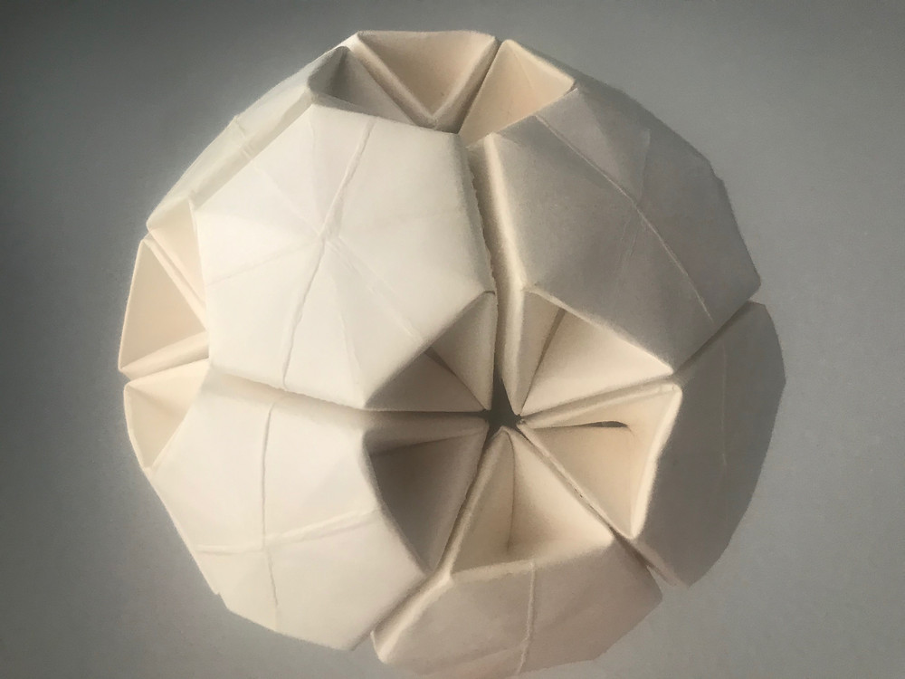 Spherical model made from paper plates by Non Techathuvanun.