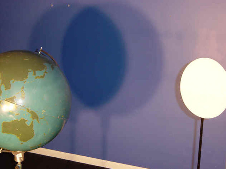 Lunar eclipse yields two shadows, shown in Lunar Eclipse Shadows activity.