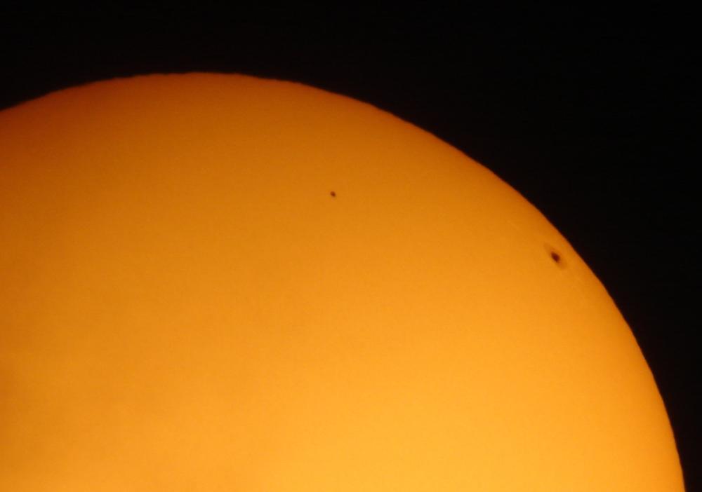 Mercury in transit appears smaller than a sunspot near the solar limb.