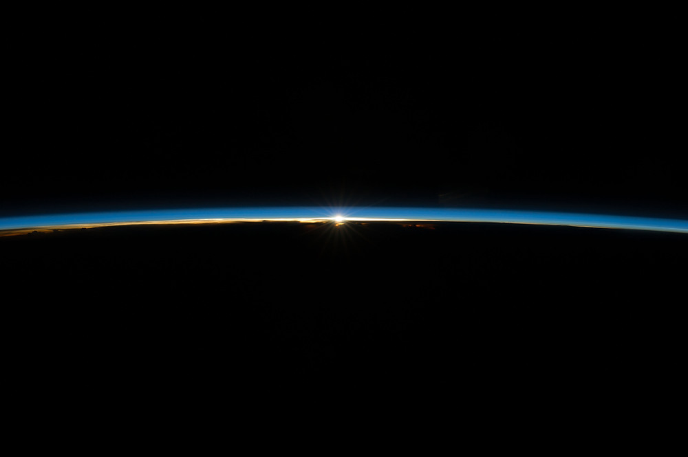 Sun rising through atmosphere as seen from ISS; image courtesy of NASA.