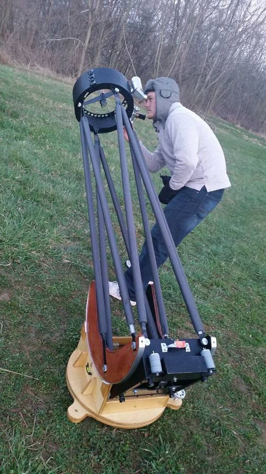 John Schrader with Fahey telescope; image courtesy of Kelly Schmitt Youngberg.