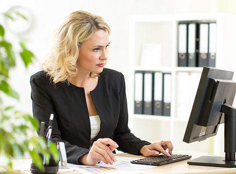 Businesswoman working with laptop at the