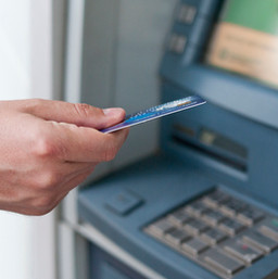 hand-inserting-atm-card-into-bank-machin