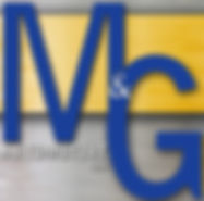 M and g automotive logo