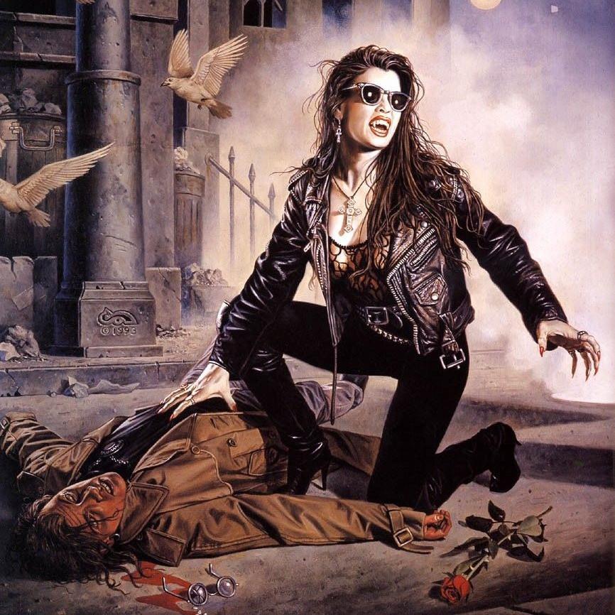 Uma vampira se alimenta de um homem caído na rua.