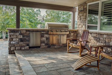 Built-in barbecue, outdoor kitchen, wine barrel adirondack chairs