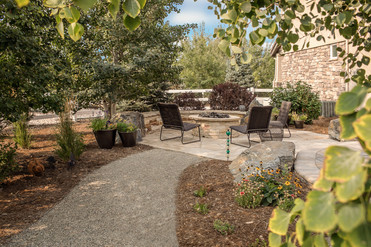 Overflow patio with stone fire pit and walkway