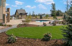 Flagstone pool deck, fire pit, and barbecue space