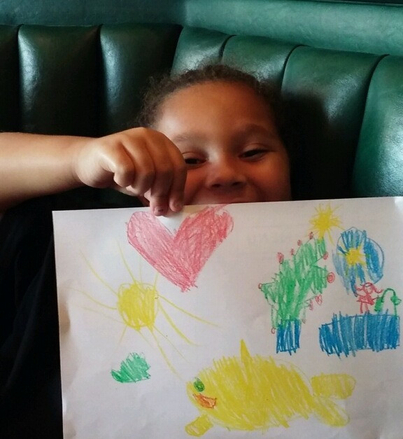 Alexis' showing me her artwork :)