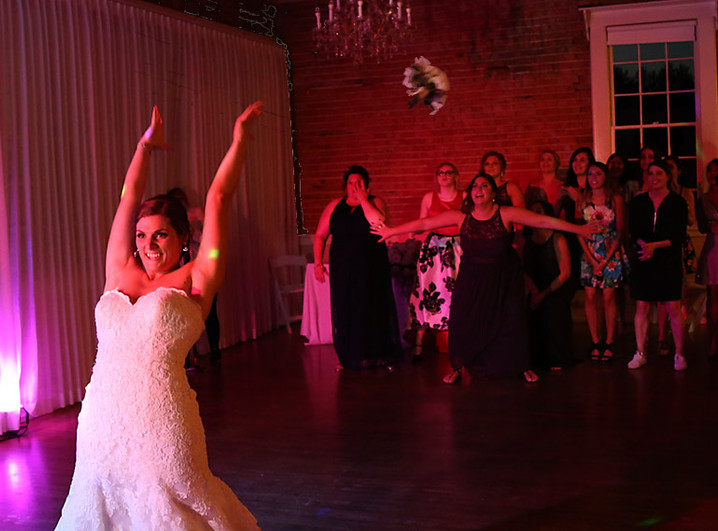 Morgan Puravet tosses her bouquet.jpg
