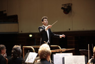 Dominic Grier conducts the Worthing Philharmonic Orchestra. Photo by Mike Austen.