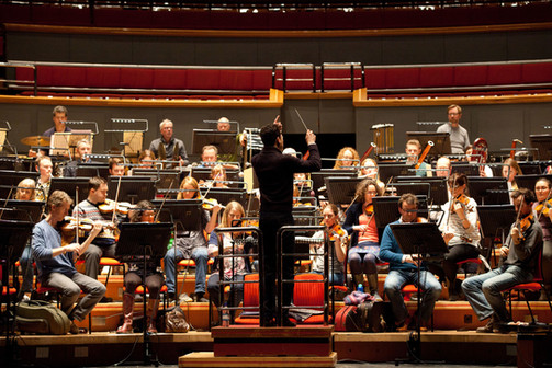 In rehearsal with the Royal Ballet Sinfonia. Photo by Caroline Holden