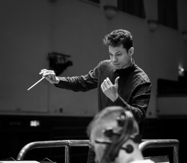 Conducting the Worhting Philharmonic Orchestra. Photo by Keith Tellick