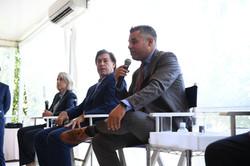 Dana Goldman, Edgardo Defortuna, & Jorge Guerra Jr speaking