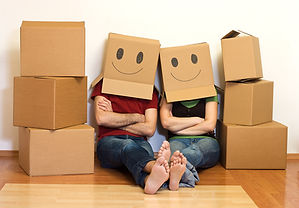 Family with Smiley Face Boxes on their Head