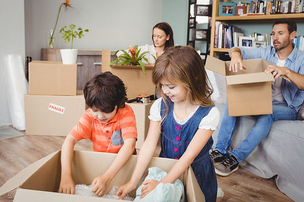 Family using Packing and Moving Supplies