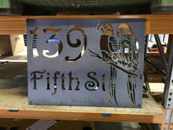 Parrot Design House Sign