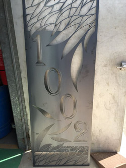 House number with gum leaves