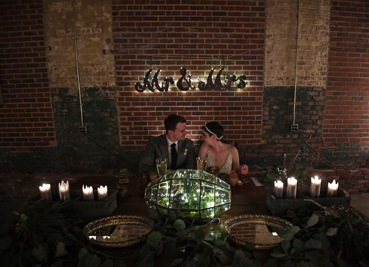 Couple's bohemian head table at Lowe Mill