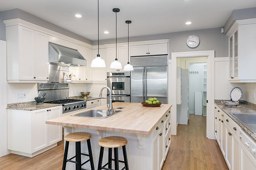 updated kitchen, bar stools, stainless steel appliances, white cupboards