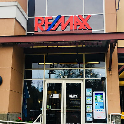 RE/MAX sign on awning over doors of building