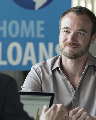 Caucasian male in a home loans office_ed