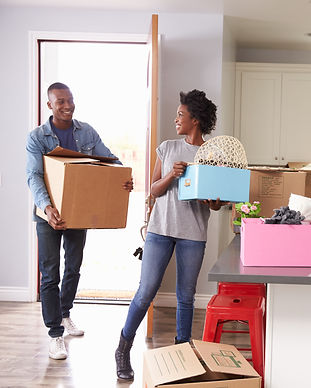 Young Couple Moving In To New Home Toget