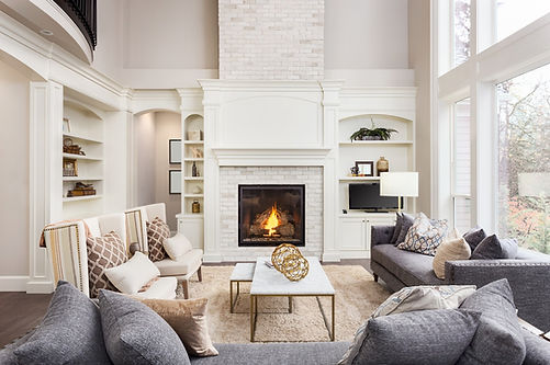 Living room, fireplace, fire burning, comfy couches, area rug, bookshelves