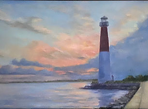 Oil painting of lighthouse at sunset