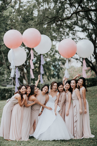 The bride and the bridesmaids were holding giant balloons in white and blush.