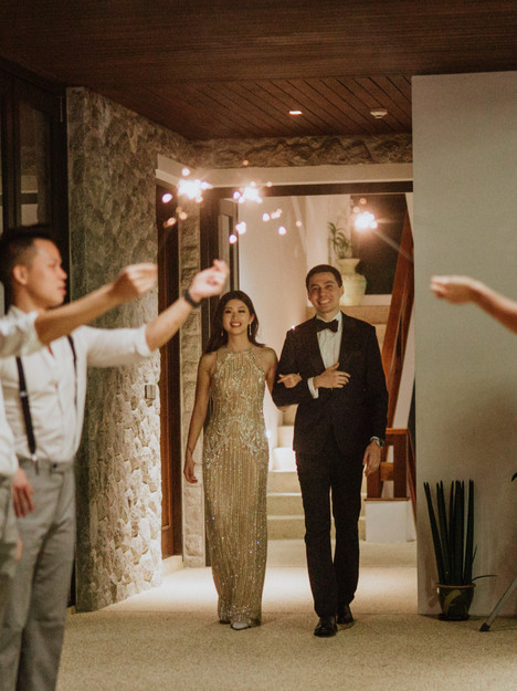 A romantic entrance of Emi and Chad as guests welcomed them with sparklers.