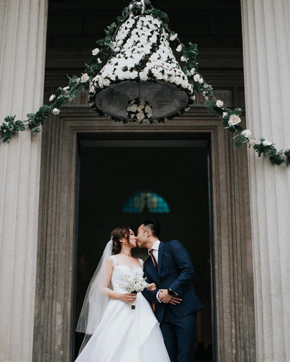 The newlyweds shared a romantic kiss after the official ceremony at St Margaret's Church.