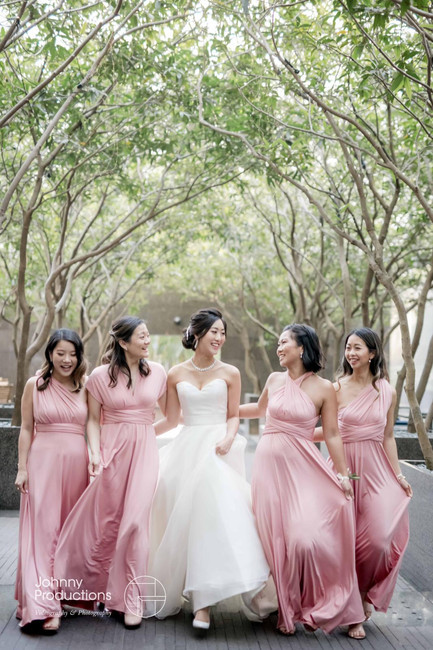 The bridesmaids were walking with the bride.