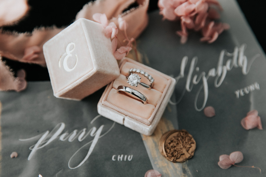 A velvet ring box and vow books made with tracing paper and dusty pink ribbons matched with the wedding color perfectly.
