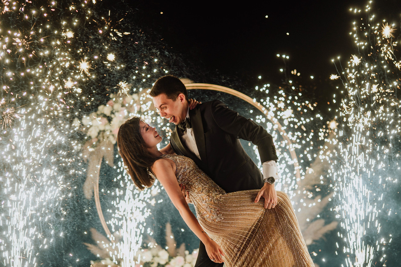A romantic couple photo in front of the fireworks.