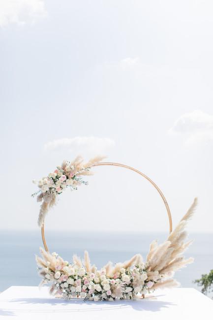 A flower arch featuring pampas grass at Villa Aye, Phuket.