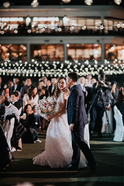 The groom surprised his bride with a singing and dancing performance.