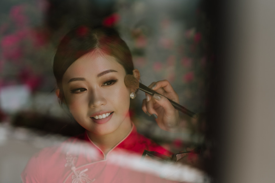 Emi Wong was putting on make-up for her wedding day.