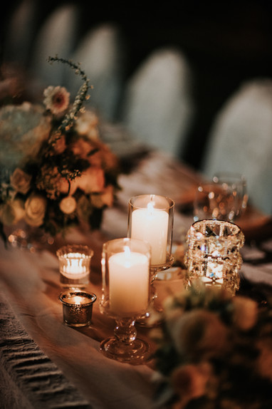 Specially designed head table arrangement with flowers and candles at the outdoor wedding banquet at The Lawn of the Beas River Country Club.