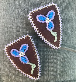 Leather post floral earrings. (sold)