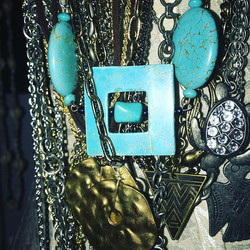 Variety of metal and stone necklaces.