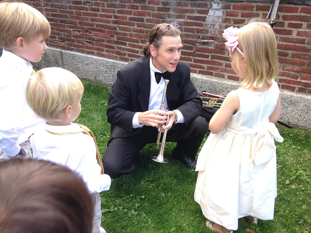 RCP trumpet player teaching moment with flower girls and ring bearers