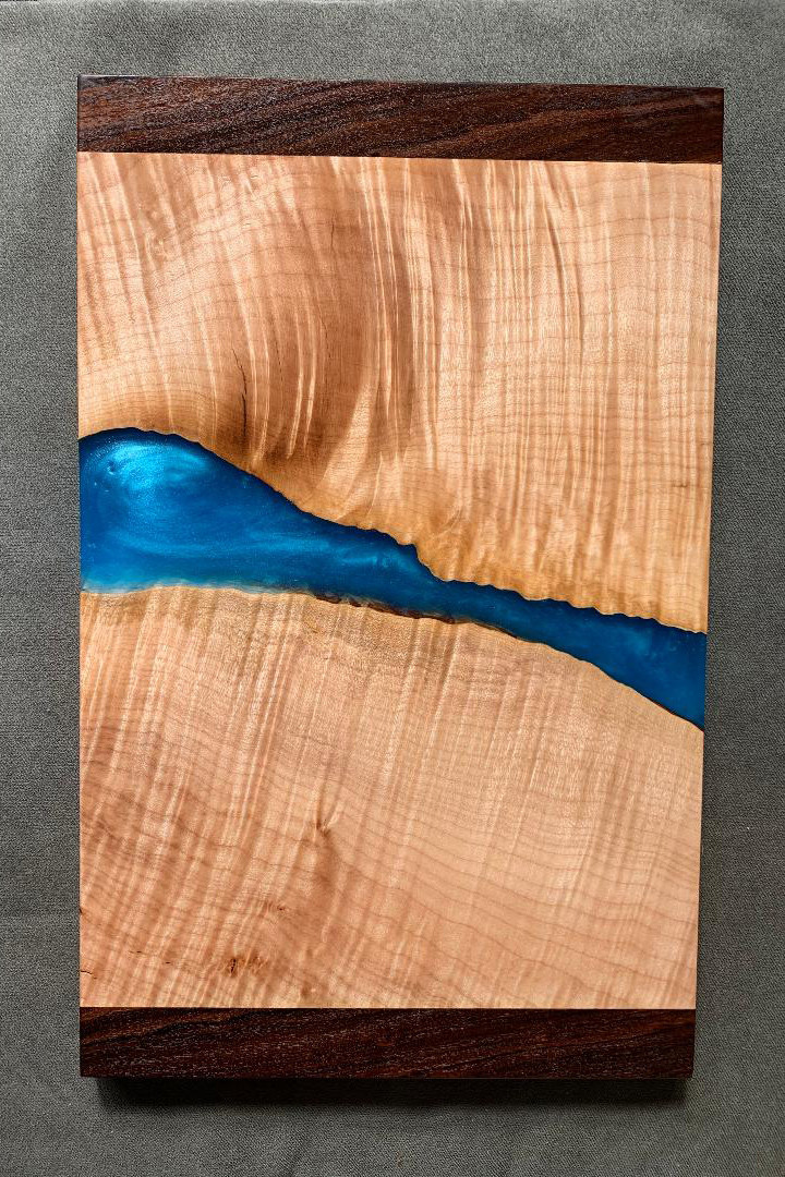 """I enjoy woodworking as well, mostly practical home renovation projects. But lately I have been playing with """"live edge"""" wood and resin projects like this maple and walnut art piece."""