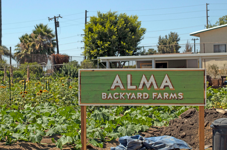 Custom Hand-painted Exterior Signage for Alma Farms in Rancho Dominguez, CA.