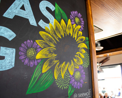 Close-up of 'Spring has Sprung' Hand-drawn Chalk Design for Simmzy's in Hungtington Beach, CA.