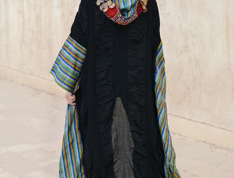The embroidery coined malas kaftan